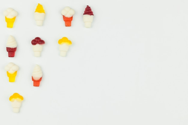 Small ice cream figures on light background