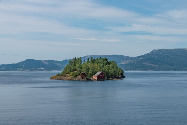 Small island in the middle of the lake in the south of norway