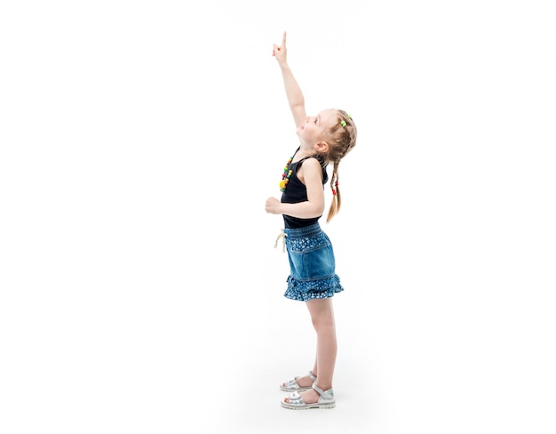 Small kid pointing upward with her finger