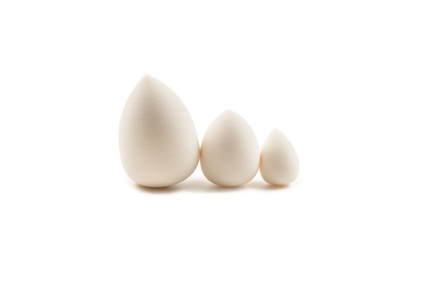 Small, medium and large  white beauty blender isolated on white.