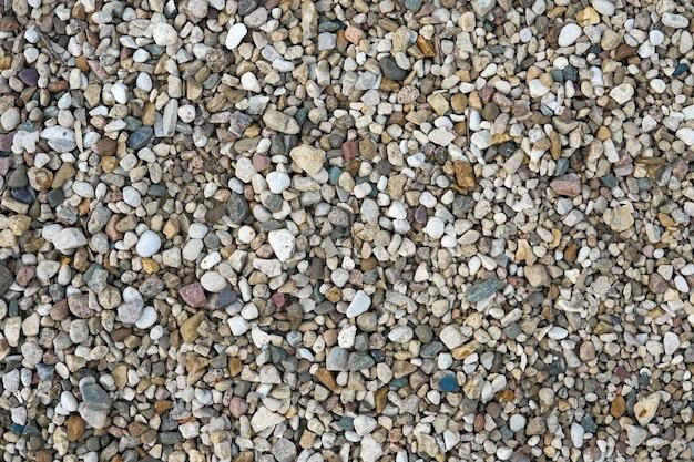 배경으로 작은 멀티 컬러 돌. 추상 자연 질감입니다. 돌 패턴입니다.