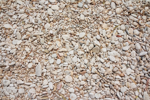 Small naturally polished rock pebbles background.