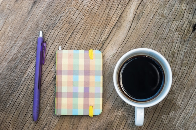 Small notebook on wood table