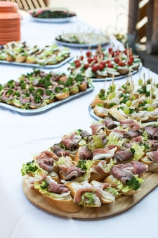 Small open sandwiches at garden party