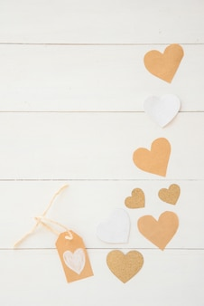 Small paper hearts scattered on table