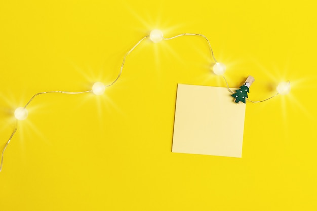 Small paper note with light garland