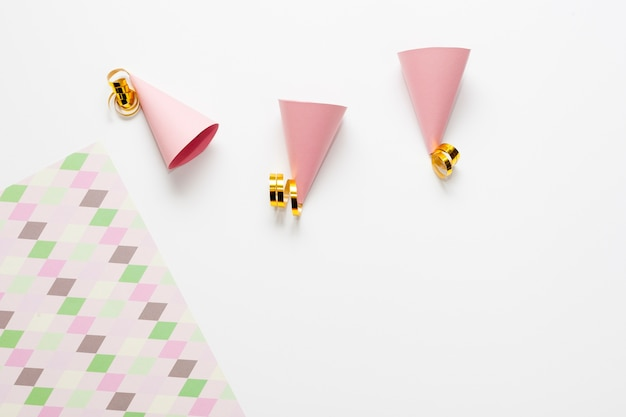 Small party hats with golden ribbons
