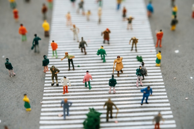 Small people or small people walk on many streets.
