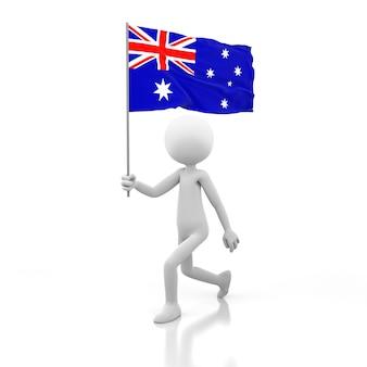 호주 국기를 손에 들고 걷는 작은 사람. 3d 렌더링 이미지