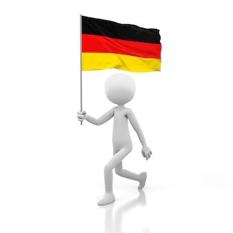 독일 국기를 손에 들고 걷는 작은 사람. 3d 렌더링 이미지