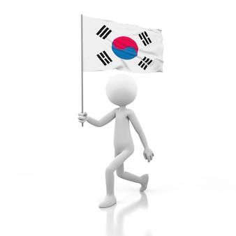 手に韓国の旗を持って歩く小さな人。 3dレンダリング画像