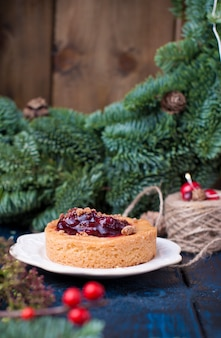 Small pie with cranberries and jam  and christmas tree