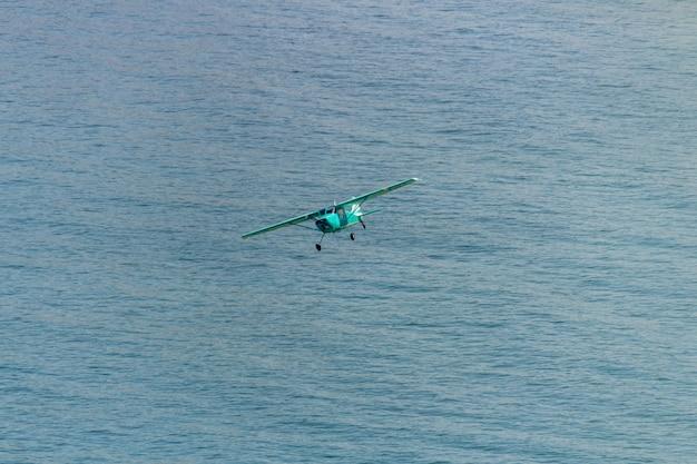Small plane flying over copacabana beach in rio de janeiro.