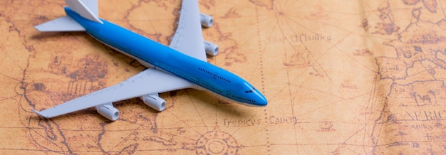 Small plane on map for plan vacation trip and accessories for travel