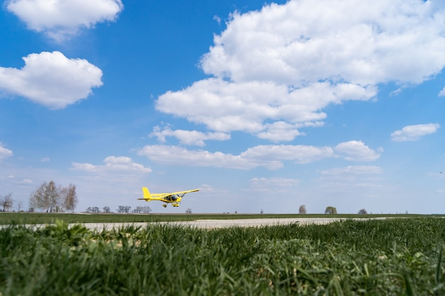 Small plane taking off from green field. concept of increase and development.