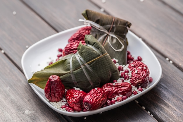 Small plate with two zongzi