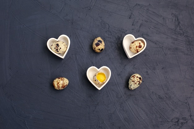 Small quail eggs on black wall. eco products.