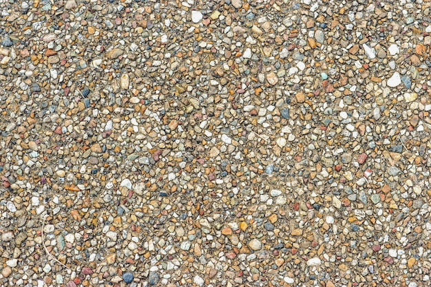 Small randon color stone surface texture road background.