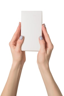 Small rectangular box in female hands. top view. isolate