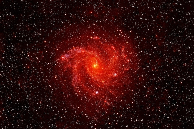 Small red galaxy on a dark background. elements of this image were furnished by nasa. high quality photo