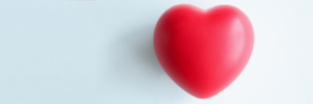 Small red heart on blue blurred background