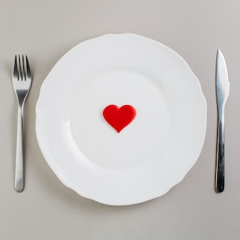 Small red heart on plate