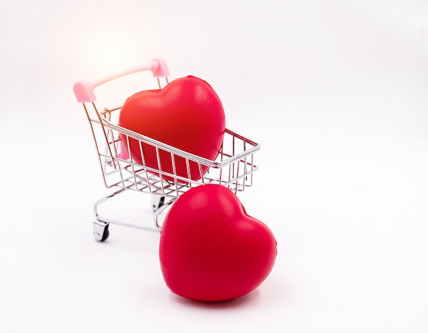 The small red heart put in shopping cart and the one put on background