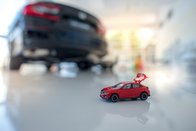Small red sedan and financial statement with coins car finance and loans, save money for car design ideas or materials