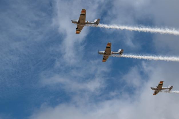 Small retro airplane, clear blue sky