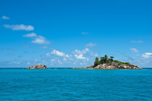 Small rocky island in the indian ocean near seychelles