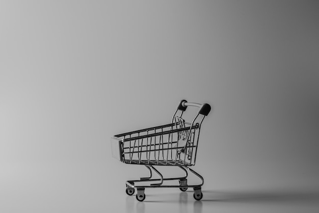 Small shopping cart on the desk.