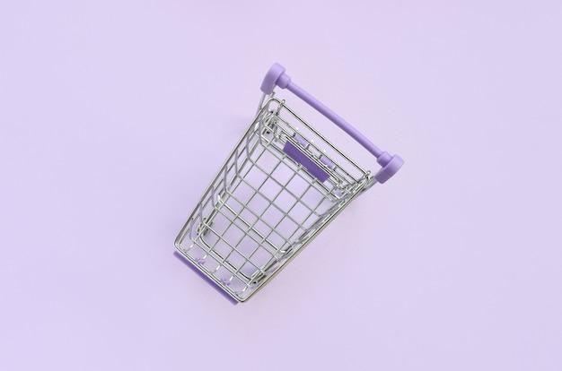 Small shopping cart. minimalism flat lay top view