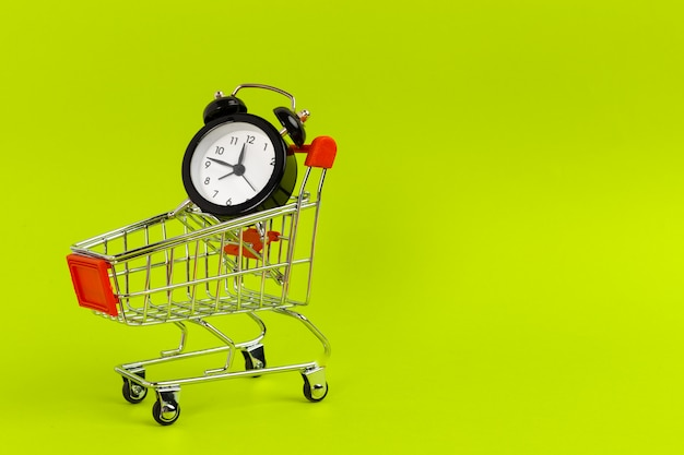 Small shopping cart with alarm clock