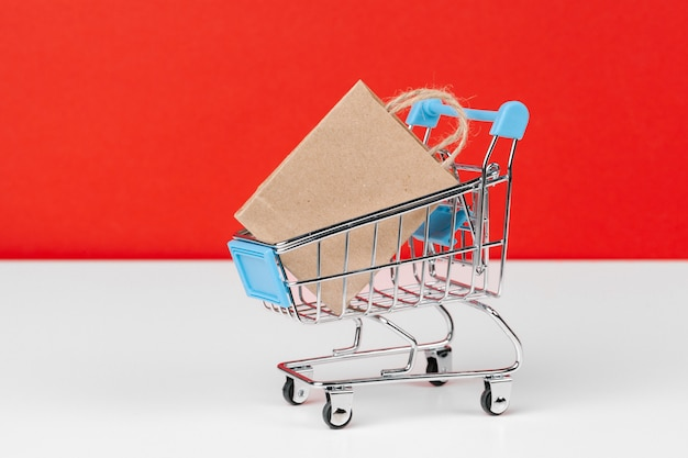 Small shopping cart with paper bags