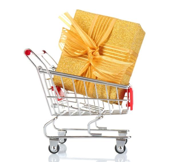 白で隔離のプレゼントボックスと小さなショッピングカート