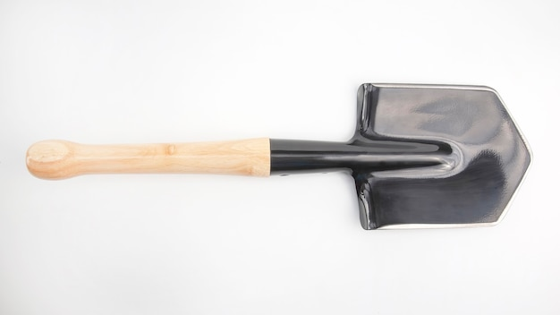 Small shovel for tourism and earthworks on a white