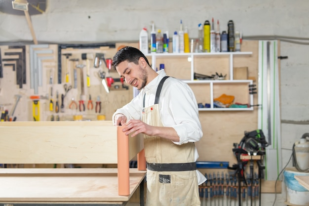 Small-sized companies, furniture production, business and people concept - man working at the