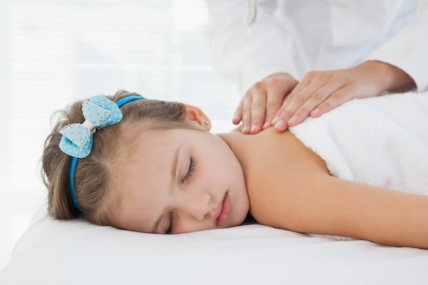 Small smiling girl lying on a table