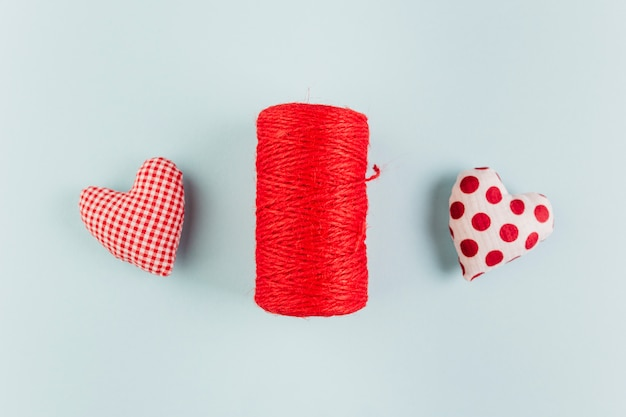Small soft bright hearts with rope roll on table