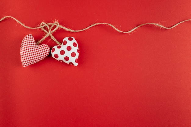 Small soft hearts with rope on table