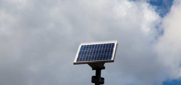Small solar panel in with cloud background
