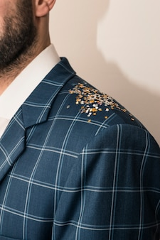 Small spangles on man shoulder