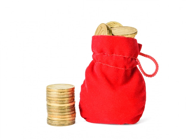Small stack of coins and pouch with coins isolated on white.