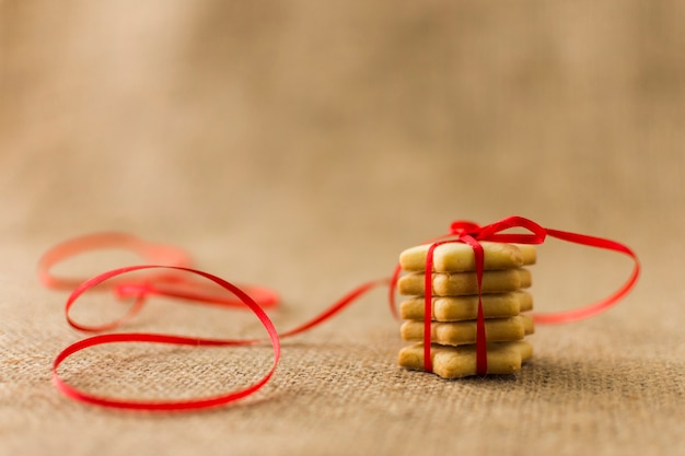 Small star cookies with red ribbon