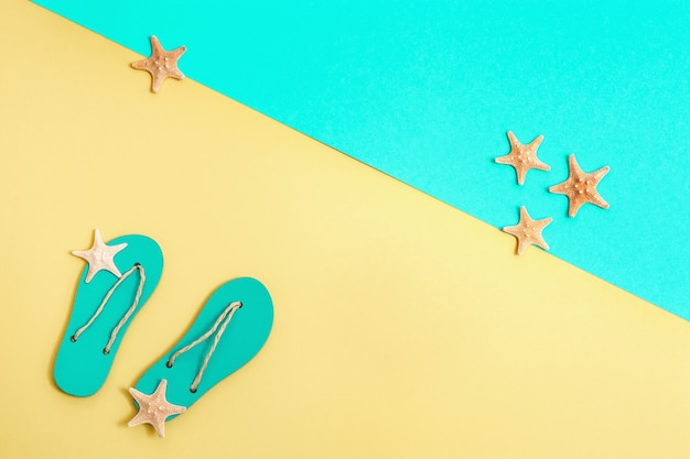 Small starfish and beach slippers, summer background