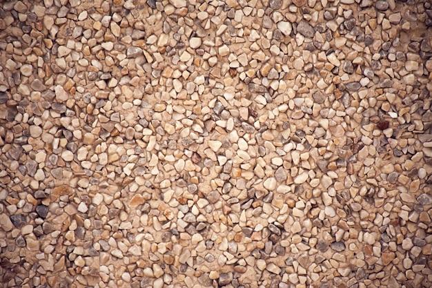 Стена текстуры малых камней. естественный фон. крупным планом выстрел