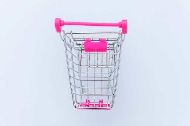 Small supermarket grocery push cart for shopping isolated on white background
