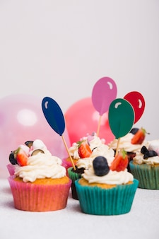 Small sweet cupcakes with balloon toppers