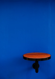 Small table on a blue wall