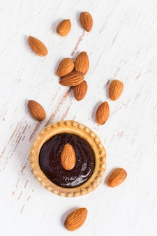Small tart with almonds and chocolate mousse, top view
